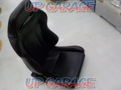 Manufacturer unknown leather reclining seat driver's side